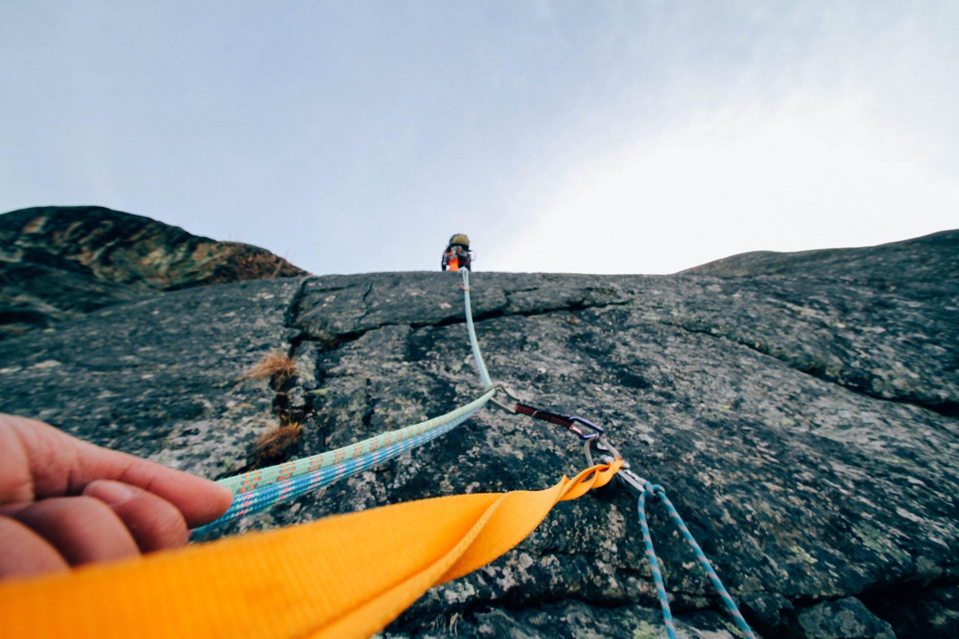 person mountain climbing